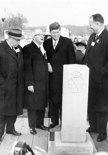 President John F. Kennedy unveils a replica of Mason-Dixon stone assisted by Maryland Governor, J. Millard Tawes, left and Governor Elbert N. Carvel, of Delaware, during ceremonies dedicating the new Maryland-Delaware turnpike. (George H. Cook/Baltimore Sun)
