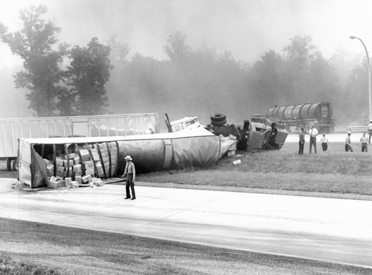 An overturned tractor-trailer is seen after an accident on I-95 in 1968. (William Mortimer/Baltimore Sun)