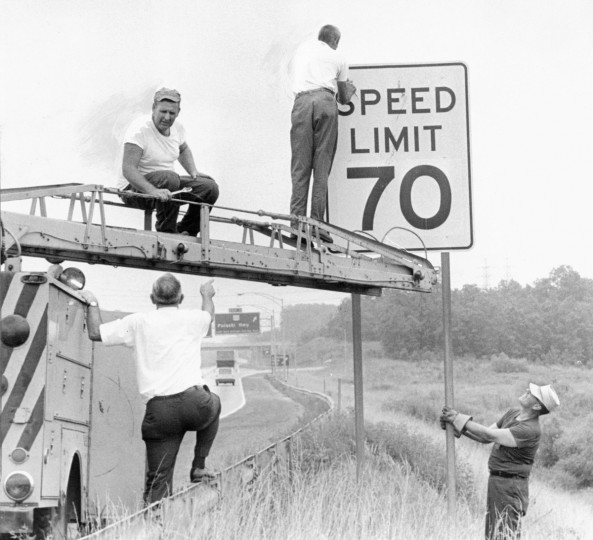 Workers install a speed limit sign along I-95 in 1969. (Baltimore Sun)