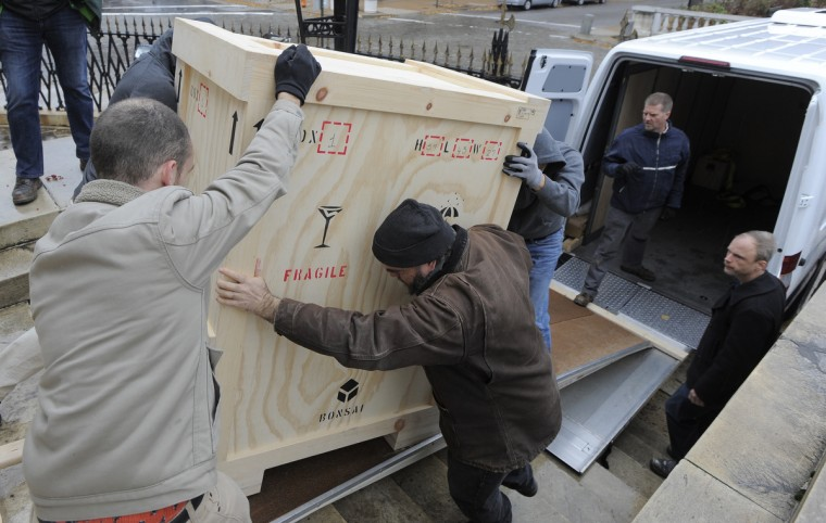The crate carrying the large bust of President George Washington is moved from the museum at the base of the Washington Monument to the Walters Art Museum Sculpture Court, where it will be on loan until the renovations at the Washington Monument are completed. (Lloyd Fox/Baltimore Sun)The crate carrying the large bust of President George Washington is moved from the museum at the base of the Washington Monument to the Walters Art Museum Sculpture Court, where it will be on loan until the renovations at the Washington Monument are completed. (Lloyd Fox/Baltimore Sun)