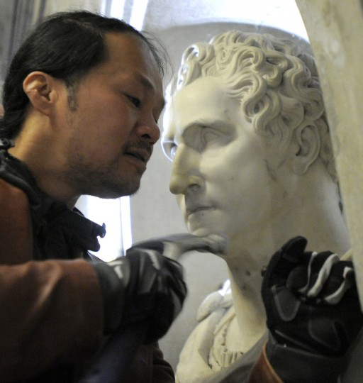 Chai Longnecker of Bonsai Fine Arts, Inc. helps get the sculpture of George Washington out of the Washington Monument. (Lloyd Fox/Baltimore Sun)