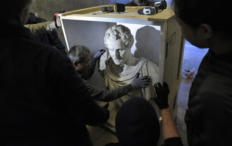 The bust of Washington is placed in a custom made box to safely ship the piece to the Walters Art Museum just down the street from the monument. (Lloyd Fox/Baltimore Sun)