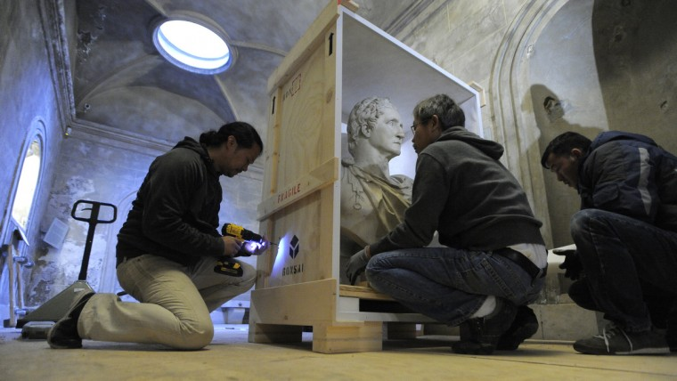 The bust is placed in a custom made box to safely ship the piece to the Walters Art Museum just down the street from the monument. (Lloyd Fox/Baltimore Sun)