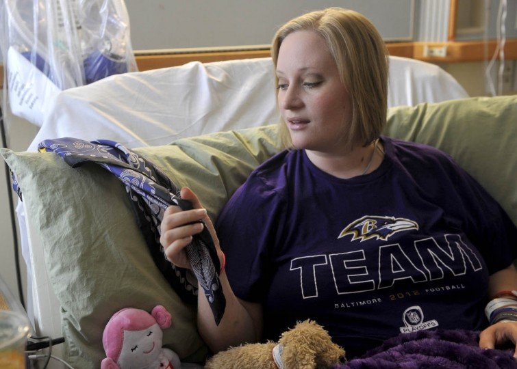 Erika Brannock talks about the scarf given to her by Amanda North, the woman who helped save her life. She is recovering from a recent surgery at the University of Maryland Medical Center. (Kim Hairston/Baltimore Sun)