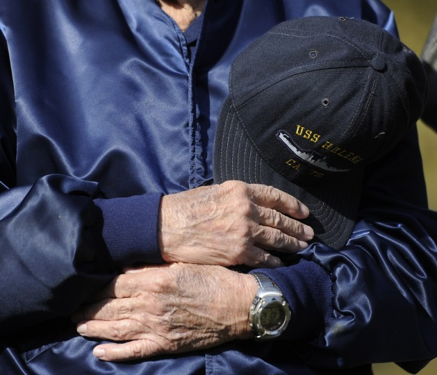 This is a detail of the hands of Ed Wall of Rosedale, who attended a Veterans Day event on the War Memorial Plaza. He served four years in the U.S. Navy on the USS Helena, a heavy cruiser, and earned four bronze stars during the Korean War. (Barbara Haddock Taylor/Baltimore Sun)