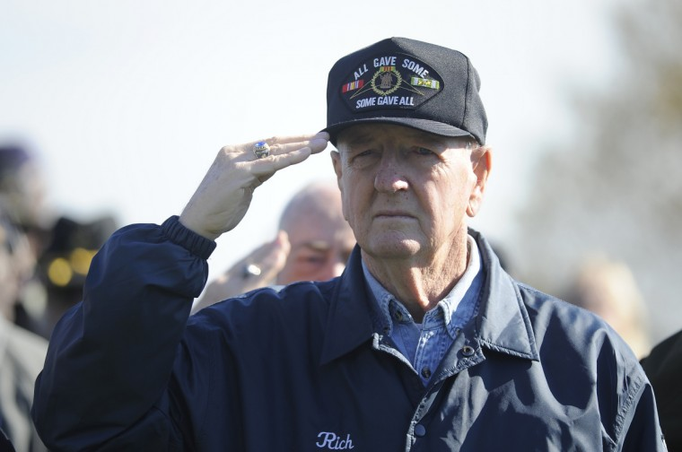 Richard Janison of Baltimore, an Air Force veteran, salutes at a Veterans Day remembrance at the Vietnam Veterans of Maryland Memorial. (Barbara Haddock Taylor/Baltimore Sun)