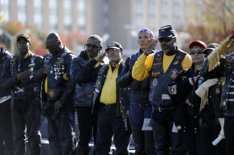Buffalo Soldiers salute at a Veterans Day remembrance at the Vietnam Veterans of Maryland Memorial. (Barbara Haddock Taylor/Baltimore Sun)