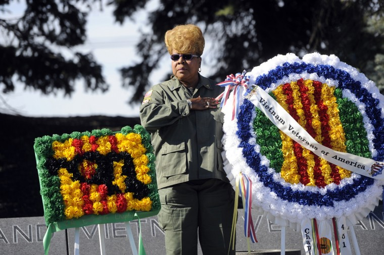 Wynonia Brown of Baltimore, a member of the Vietnam Veterans of America chapter 451 Honor Guard, placed a wreath at a Veterans Day remembrance at the Vietnam Veterans of Maryland Memorial. (Barbara Haddock Taylor/Baltimore Sun)