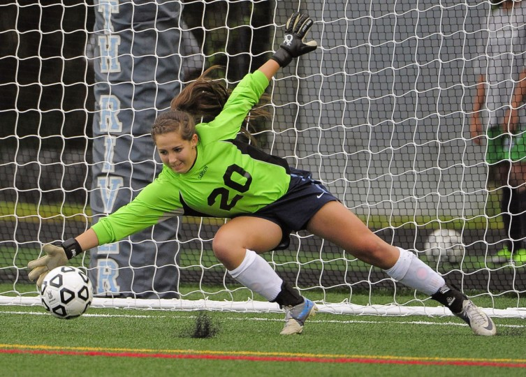 South River goalkeeper Emily Proctor dives to stop a shot by Arundel. The Seahawks shocked the Wildcats in sudden death overtime, 3-2. (Karl Merton Ferron/Baltimore Sun)