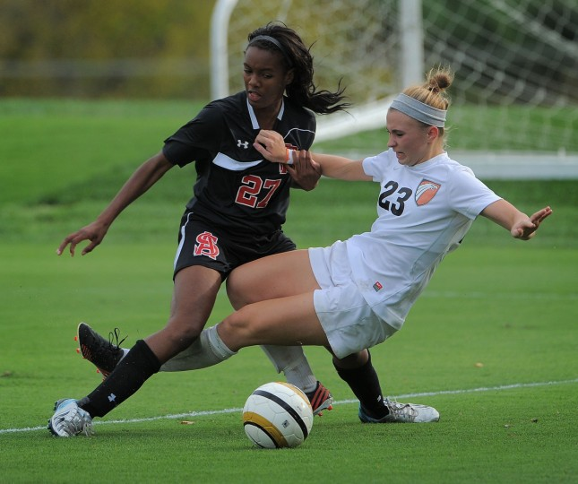 McDonogh forward Anna Bialczak slides under the legs of Spalding defender Jernelle John. (Karl Merton Ferron/Baltimore Sun)