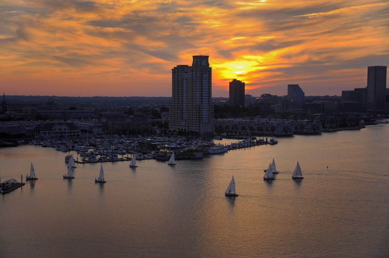 Sailboats return for the day in a view from the top of the Domino Sugars refinery, above the inner harbor Thursday, Jun. 20, 2013. (Karl Merton Ferron/Baltimore Sun Staff)