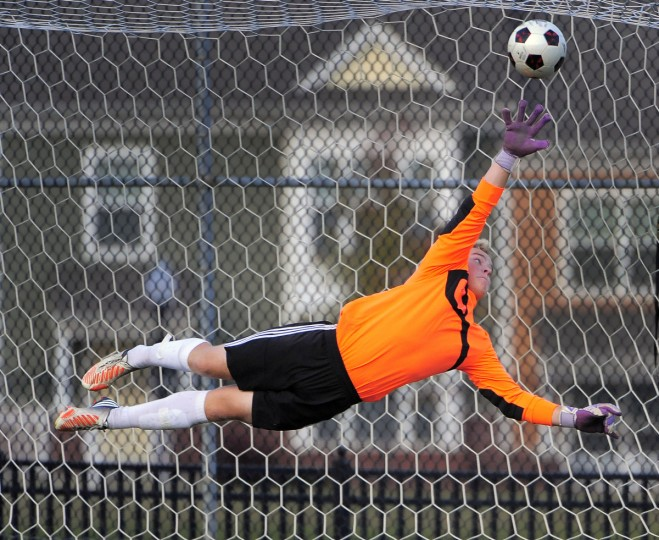 A shot attempted by McDonogh midfielder Bahar Piroz (not in picture) slices above Archbishop Curley goalkeeper Colin Brown in the second half. McDonogh prevailed, 3-1. (Karl Merton Ferron/Baltimore Sun Staff)