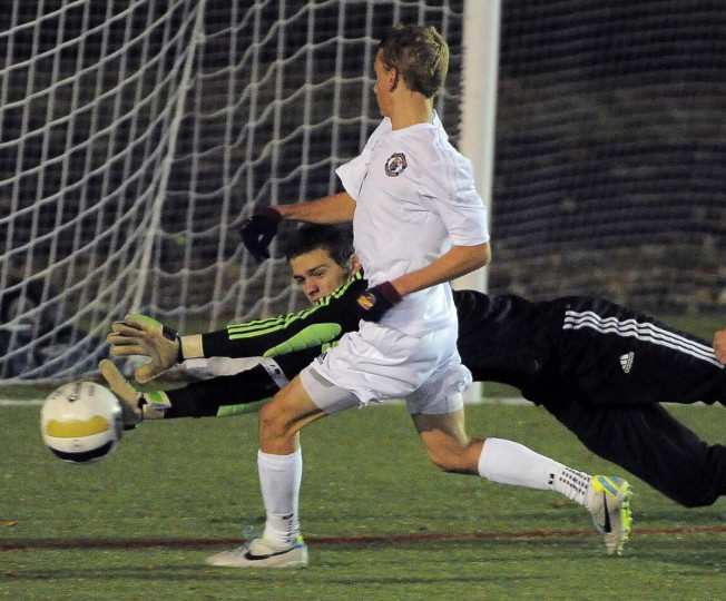 Severna Park's Karl Schmidt races to the ball, but Leonardtown goalkeeper Trevor Young stretches to deflect the shot in the MPSSAA boys' soccer playoffs. (Karl Merton Ferron/Baltimore Sun)