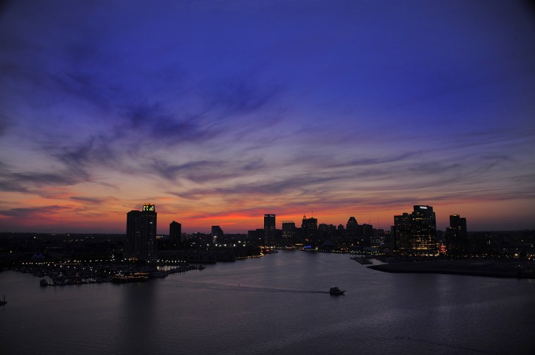 The glow of the city lights begin to equalize after the sun sets in a view from the top of the Domino Sugars refinery, above the inner harbor Thursday, Jun. 20, 2013. (Karl Merton Ferron/Baltimore Sun Staff)