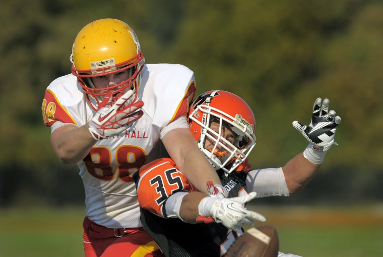 McDonogh linebacker Cameron Harrell is hit from behind as he almost intercepts a pass intended for Calvert Hall receiver Erik Evans. The Eagles beat the Cardinals, 48-13. (Karl Merton Ferron/Baltimore Sun)