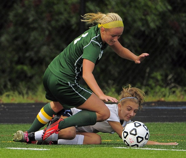 South River forward Kenidy Springer tumbles below Arundel forward/midfielder Becky Frost (1). The Seahawks shocked the Wildcats in overtime, 3-2. (Karl Merton Ferron/Baltimore Sun)