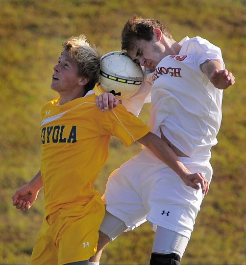 McDonogh's Brett Abel, right, battles head-to-head with Loyola's Sean Clark in the second half. The Eagles blanked the Dons, 3-0. (Karl Merton Ferron/Baltimore Sun)