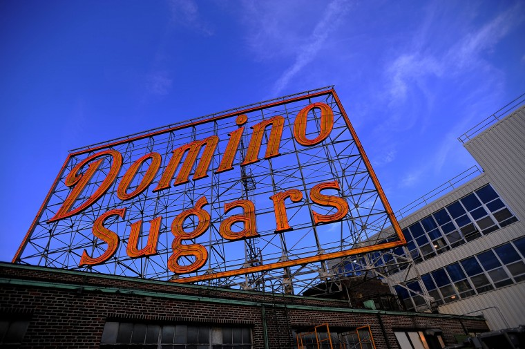 The glow of the neon sign is on even during daylight in a view from the top of the Domino Sugars refinery, above the inner harbor Thursday, Jun. 20, 2013. (Karl Merton Ferron/Baltimore Sun Staff)