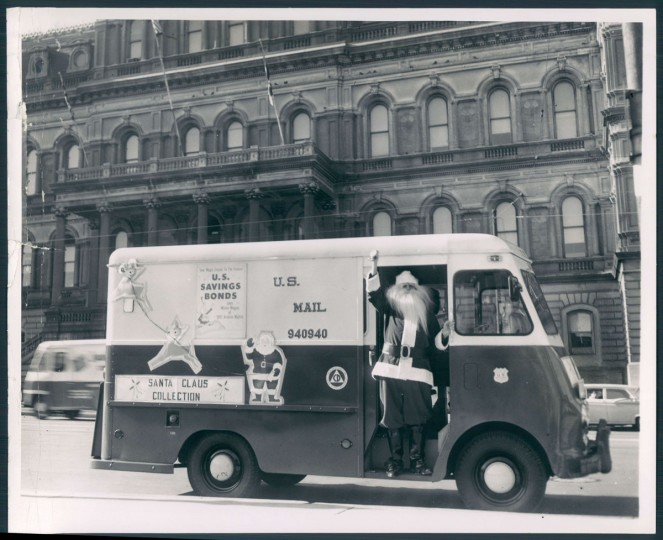 Santa Claus (Albert Magowski) waves from a mail truck in front of City Hall. Dec. 18, 1959. (Walter McCardell/Baltimore Sun)