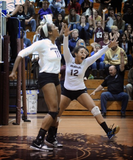 Broadneck's Dallas Jasper, left, and Jordyn Beans celebrate after the Bruins defeated South River in Game 5 to win the 2013 Anne Arundel County volleyball championship.(Kenneth K. Lam/Baltimore Sun)