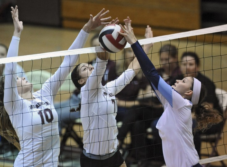South River's Rachel Pierson, right, tries to get the ball over the block attempt by Broadneck's Sophia Shepard, left, and Francesca Howard, center, during the third game. Broadneck defeated South River to win the 2013 Anne Arundel County volleyball championship. (Kenneth K. Lam/Baltimore Sun)