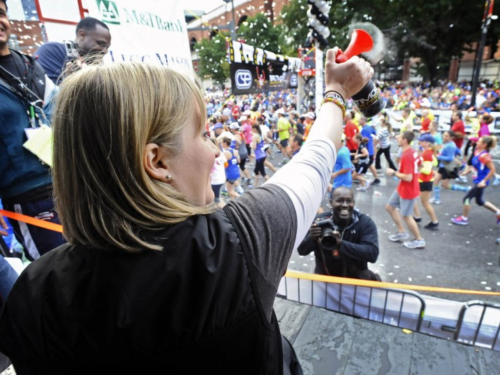 Honorary starter Erika Brannock, a survivor of the Boston Marathon terrorist bombing attack, blows the air horn to start the 2013 Baltimore Marathon during the13th Annual Baltimore Running Festival. (Kenneth K. Lam/Baltimore Sun)