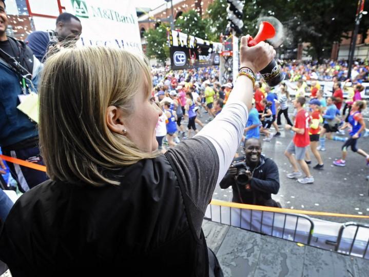 Honorary starter Erika Brannock, a survivor of the Boston Marathon terrorist bombing attack, blows the air horn to start the 2013 Baltimore Marathon during the13th Annual Baltimore Running Festival. (Kenneth K. Lam/Baltimore Sun)