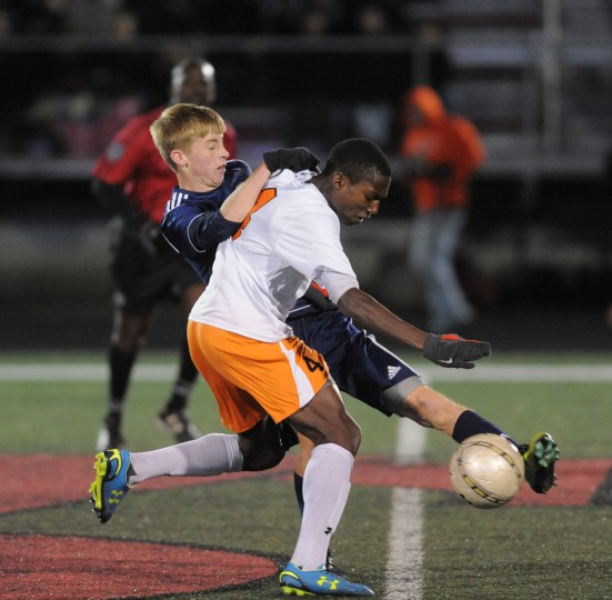 McDonogh's Eramuse Momoh, in front, and St. Paul's Morgan Lussi fight for the ball in the second half. McDonogh won the 2013 MIAA A Conference Boys Soccer Championship. (Algerina Perna/Baltimore Sun)