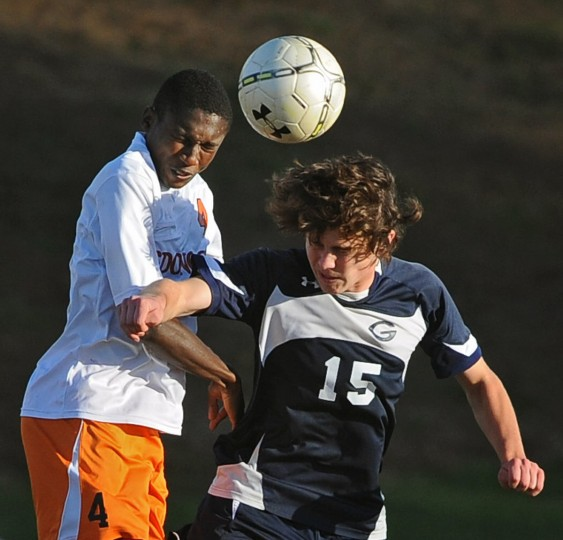 McDonogh's Eramuse Momoh, left, battles Gilman's Cole Sutton for a header in the second half. McDonogh defeated Gilman, 4-0, n the MIAA A Conference boys soccer semifinals. (Kenneth K. Lam/Baltimore Sun)