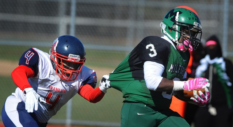 Franklin's Kiandre Burrell, left, grabs the jersey of Milford Mill's Jamaal Morant, right, during a run in the first quarter. Franklin defeated Milford Mill, 35-18. (Kenneth K. Lam/Baltimore Sun)