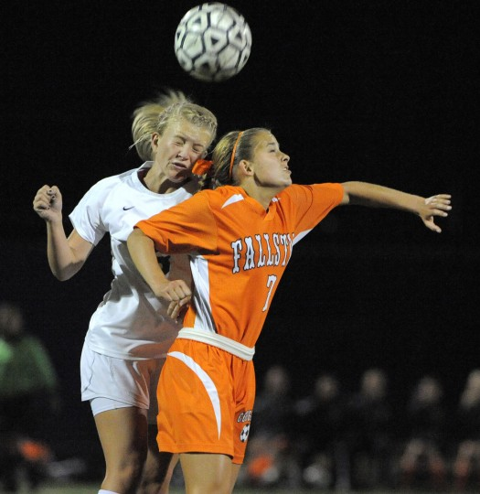 Bel Air's Jordan Layfield, left, and Fallston's Beth Walton fight for a loose ball in the second half. (Lloyd Fox/Baltimore Sun)