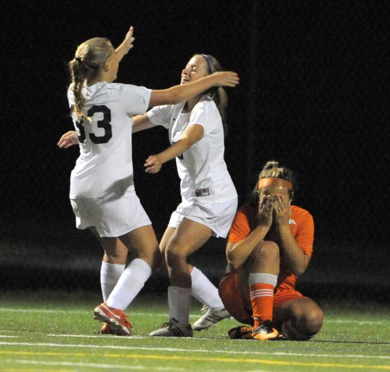Bel Air's Jamie Layfield, left, celebrates with Natalie Decker after their team scored the go-ahead goal late in the second quarter. Fallston's Logan Gasior covers her face in reaction to the goal. (Lloyd Fox/Baltimore Sun)