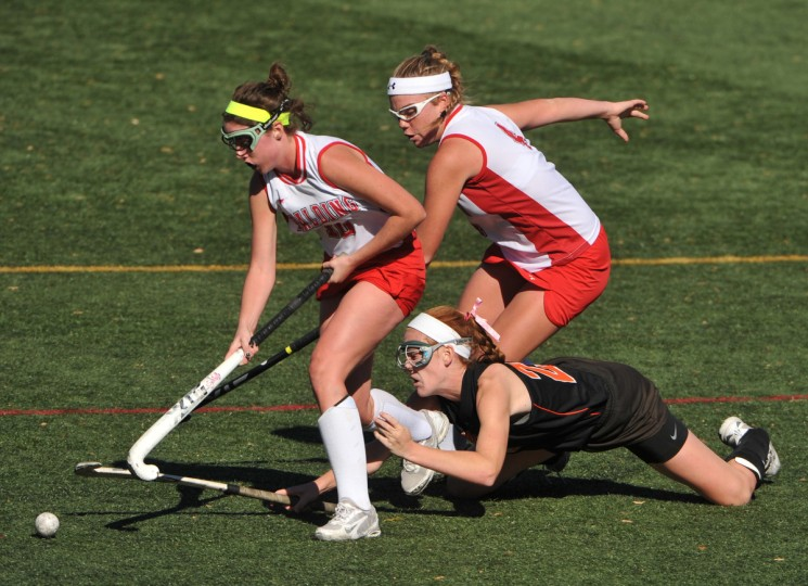 while Logan Edmondson follows the play. Spalding won the IAAM A Conference field hockey title in sudden death OT, 2-1. (Amy Davis/Baltimore Sun)