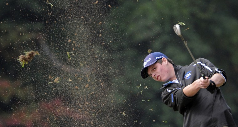 Churchill's Luke Schaap hits a shot from the 17th fairway during the 1A/2A, 3A/4A Maryland state championship golf match at the University of Maryland Golf Course in College Park. (Lloyd Fox/Baltimore Sun)