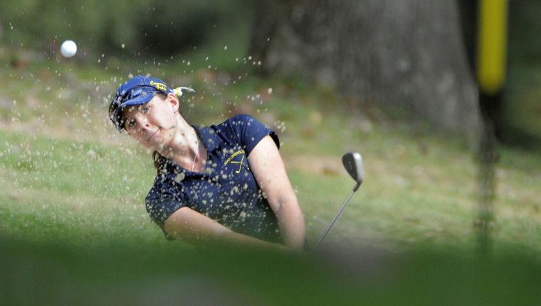 Killian Casson of Catonsville chips out of the sand on the second hole during the 1A/2A, 3A/4A Maryland state championship golf match at the University of Maryland Golf Course in College Park. (Lloyd Fox/Baltimore Sun)