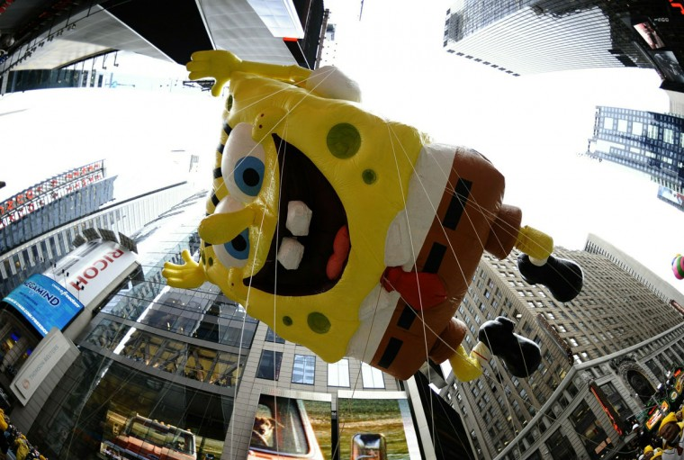 SpongeBob Squarepants floats down Broadway in Times Square as he joins the giant balloon lineup for the 84th annual Macy's Thanksgiving Day Parade in New York November 25, 2010. (Timothy A. Clary/AFP/Getty Images)