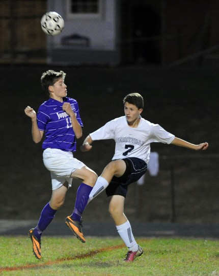 Perryville's Sarp Hamamcioglu kicks the ball away as Joppatowne's Dylan Boblitz leaps in to attempt the block during Tuesday's regional play-off game at Perryville. (Matt Button/BSMG)
