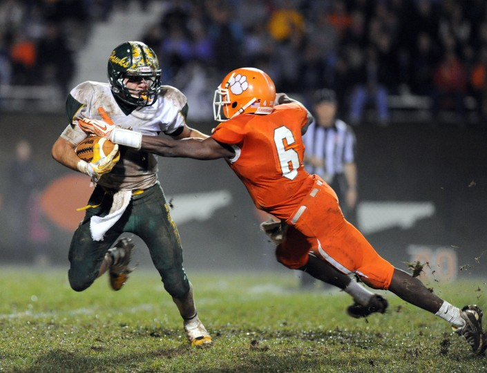 Fallston's Vance Adesanya tries to take down North Harford's Ryan Feiss on a kick return during Friday night's game at Fallston. (Matt Button/BSMG)