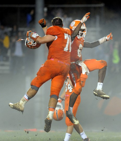 Fallston teammates Levi Lloyd, left, and Vance Adesanya celebrate after Friday night's 19-14 win over North Harford. (Matt Button/BSMG)