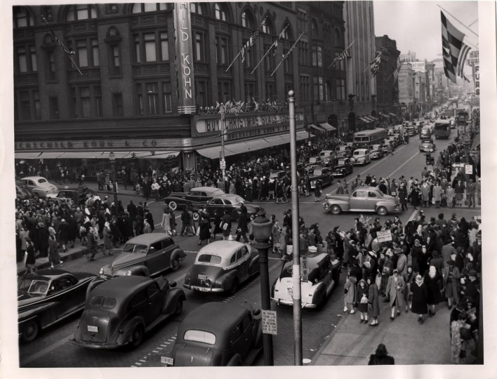 The intersection of Lexington and Howard streets once marked the heart of Baltimore's shopping district with its numerous department stores, such as Hochschild Kohn. In this 1947 photo, crowds of shoppers line the sidewalks amid a busy stream of cars and buses. Photo by Robert Mottar