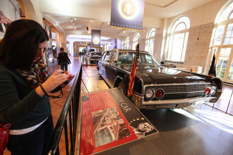 Michelle Tedesco, of Los Angeles, takes a photograph of the customized 1961 Lincoln Continental four-door convertible, Nov. 14, 2013, at the Henry Ford Museum in Dearborn, Mich. This is the vehicle President John F. Kennedy was riding in when he was assassinated in 1963. (Jessica J. Trevino/MCT/Detroit Free Press)