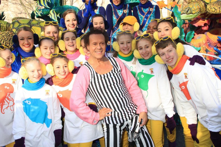 Richard Simmons strikes a pose with kids during the Macy's Thanksgiving Day Parade in New York on Thursday, Nov., 28, 2013. (John Barrett/Gobe Photos via Zuma Press/MCT)
