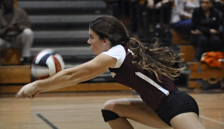 Broadneck's Katie Byrne makes a dig during the fifth and deciding game in which the Bruins defeated South River to win the 2013 Anne Arundel County volleyball championship. (Kenneth K. Lam/Baltimore Sun)