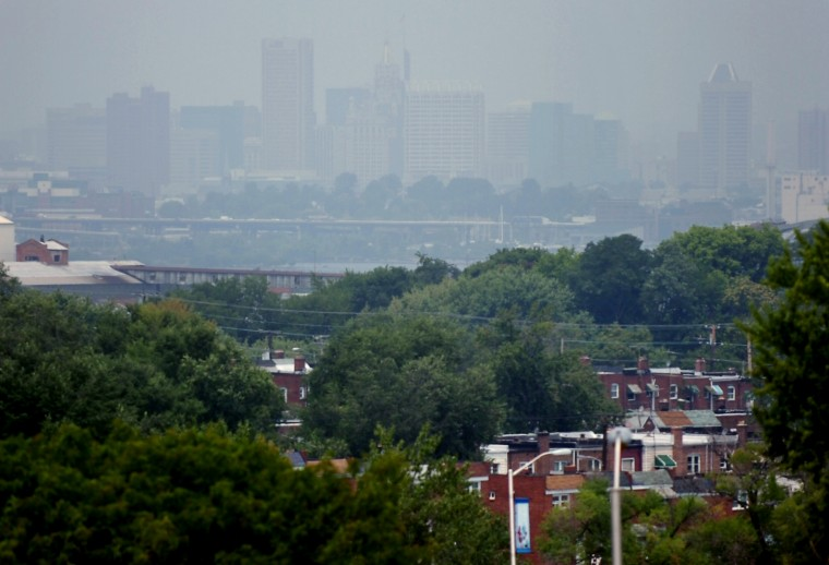 The Baltimore skyline is barely visible from W. Bay Avenue through the thick haze that hangs over the area. (Kim Hairston/Baltimore Sun Photo/Aug., 7, 2007)