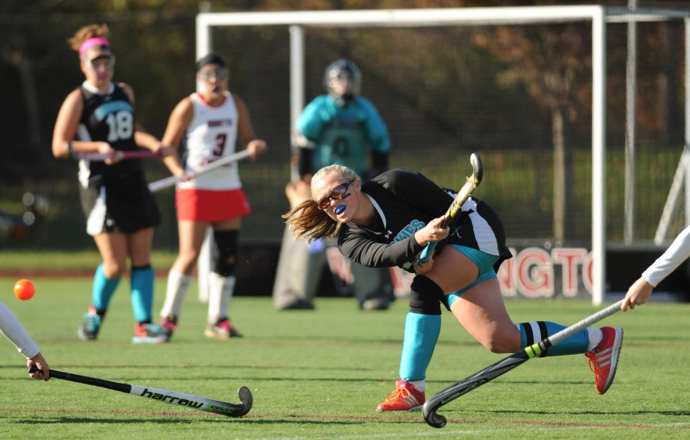 Jaelyn Felts of Patterson Mill sends the ball over the stick of a North Carroll opponent during the Class 1A state field hockey championship game at Washington College in Chestertown on Saturday, November 9, 2013. (Brian Krista/BSMG)