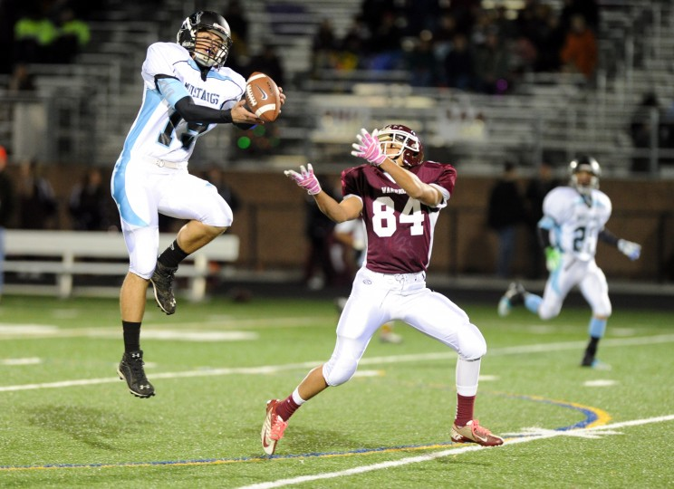Ben Rampolla of C. Milton Wright makes a leaping interception on a pass intended for Jordan Lynam of Havre de Grace during a football game at Havre de Grace High School on Friday, November 8, 2013. (Brian Krista/BSMG)
