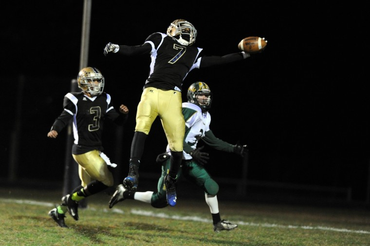 TyRell Hollingsworth of Perryville, center, makes a one-handed interception in front of teammate Eathen Griffin, left, and intended North Harford receiver Richie Greene during a football game at Perryville High School on Friday, November 8, 2013. (Brian Krista/BSMG)