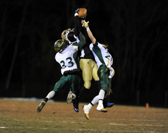 TyRell Hollingsworth of Perryville, center, makes a leaping catch between North Harford defenders Richie Greene, left, and Ryan Feiss during a football game at Perryville High School on Friday, November 8, 2013. (Brian Krista/BSMG)