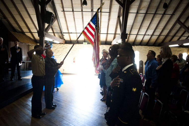 Walter E. Guntler Jr. holds the flag aloft during the singing of the National Anthem at the Veterans Day celebration at CCBC on Monday, November 11th. (Noah Scialom/BSMG)