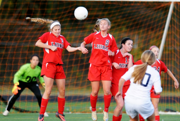 Dulaney players form a wall to help prevent a goal on a penalty kick attempt by Catonsville's Allison Dingle during the regional quarterfinals at Catonsville High School on Tuesday, Oct. 29, 2013. (Jon Sham/BSMG)